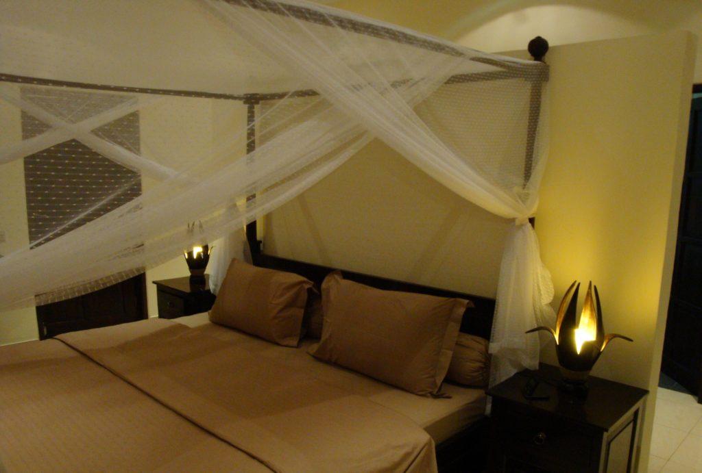 Slaapkamer met 2 persoons bed op Bali